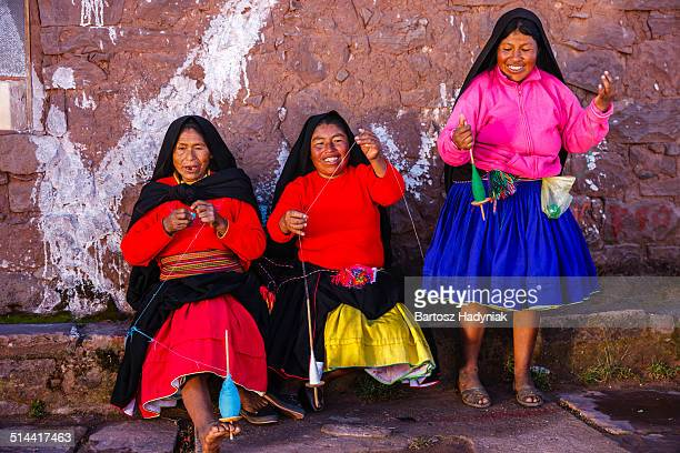 Peruvian women spinning wool on Taquile Island