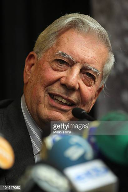 Peruvian writer Mario Vargas Llosa smiles at a press conference at Instituto Cervantes after he won the 2010 Nobel Prize in literature October 7 2010...