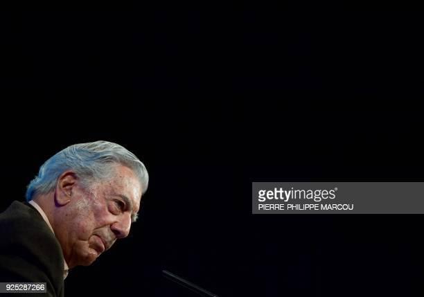 Peruvian writter Mario Vargas Llosa looks on during the presentation of his book 'La llamada de la tribu' in Madrid on February 28 2018 / AFP PHOTO /...