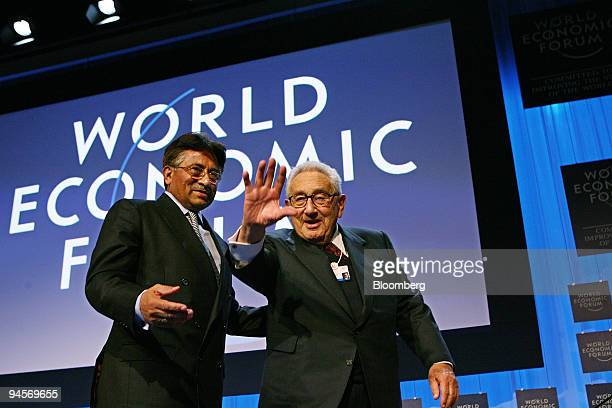 Pervez Musharraf president of Pakistan left and Henry Kissinger former US secretary of state leave the stage following a session entitled ''Three...