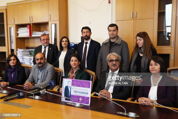 Pervin Buldan coleader of the proKurdish Peoples Democratic Partiy addresses the media as she is accompanied by lawmakers before starting a twoday...