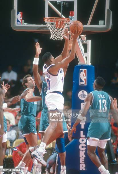 Pervis Ellison of the Washington Bullets shoots against the Charlotte Hornets during an NBA basketball game circa 1992 at the Capital Centre in...