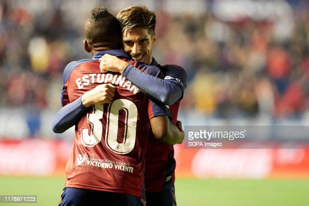 Pervis Estupiñan celebrates a goal with Nacho Vidal during the Spanish La Liga Santander match between CA Osasuna and Valencia CF at the Sadar...