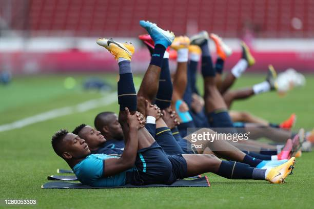 Pervis Estupiñan of Ecuador and teammates stretch during a match between Ecuador and Uruguay as part of South American Qualifiers for Qatar 2022 at...