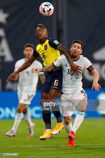 Pervis Estupiñán of Ecuador fights for the ball with Lionel Messi of Argentina during a match between Argentina and Ecuador as part of South American...