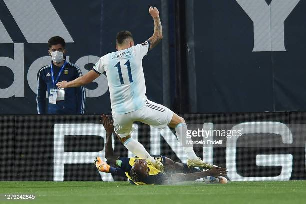 Pervis Estupiñán of Ecuador makes a foul to Lucas Ocampos of Argentina during a match between Argentina and Ecuador as part of South American...