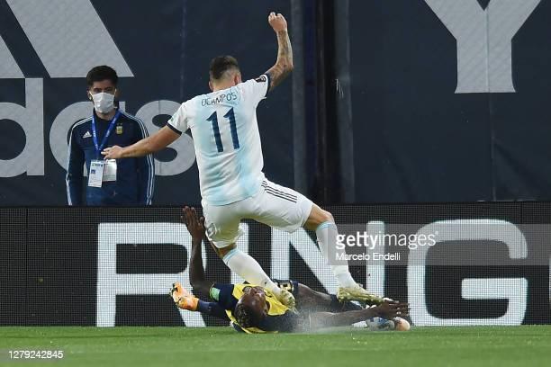 Pervis Estupiñán of Ecuador makes a foul to Lucas Ocampos of Argentina during a match between Argentina and Ecuador as part of South American...