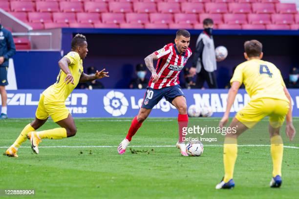 Pervis Estupinan of Villarreal CF Angel Correa of Atletico de Madrid and Pau Torres of Villarreal CF battle for the ball during the La Liga Santader...