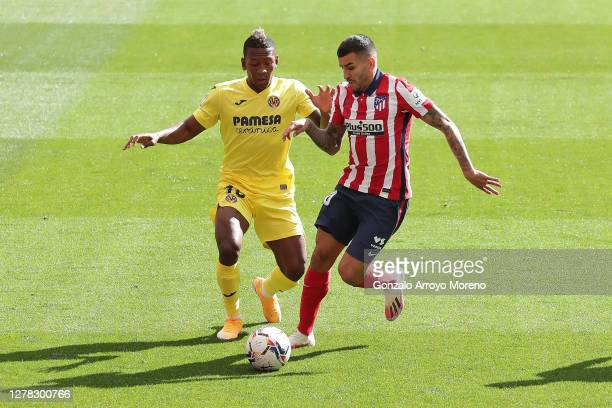 Pervis Estupinan of Villarreal CF competes for the ball with Angel Martin Correa of Atletico de Madrid during the La Liga Santader match between...