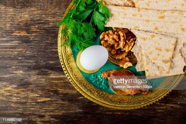 pesah concept jewish passover holiday traditional pesah seder plate with celery, egg, bone, - passover seder plate stock pictures, royalty-free photos & images