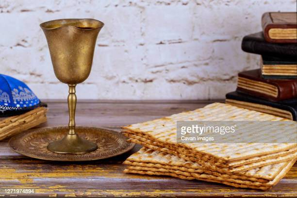pesah holiday celebration, matza unleavened bread and cup kosher wine - jewish prayer shawl stock pictures, royalty-free photos & images