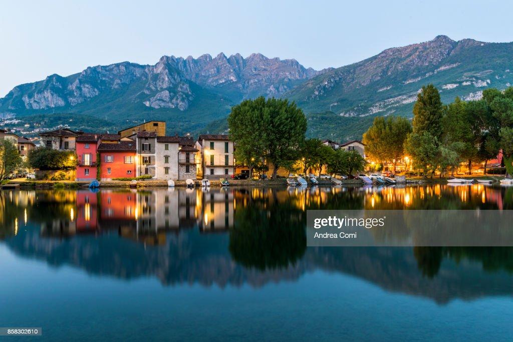 Pescarenico, Lecco, Lombardy. Pescarenico village at dusk. Resegone mountain in the background : Stock Photo