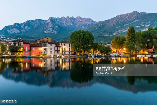 Pescarenico, Lecco, Lombardy. Pescarenico village at dusk. Resegone mountain in the background