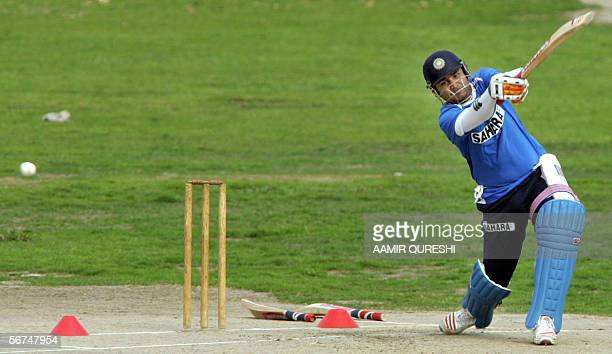 Indian cricketer Virender Sehwag hits the ball during a practice session at The Peshawar Gymakhana in Peshawar 05 February 2006 Dravid hoped...