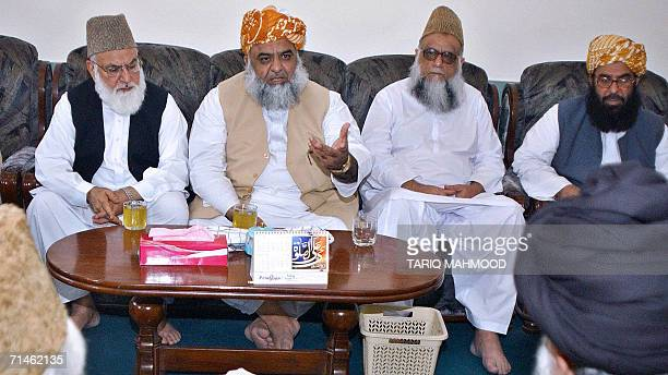 Maulana FazalurRehman the leader of Pakistan's sixparty Islamic alliance Muttahida MajliseAmal gestures during an alliance's Supreme Council meeting...