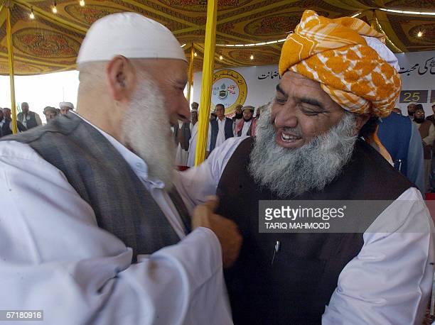 Maulana Fazlur Rehman leader of the hardline Muttahida MajliseAmal hugs with the former imam of Palestinian Mosque Aqsa Shiekh Ahmed Mahmood Siyam...
