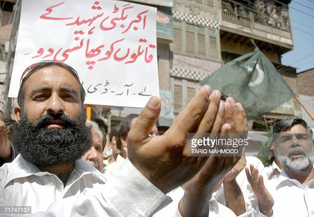 Pakistani activists of the opposition Alliance for Restoration of Democracy offer prayers for rebel tribal chief Nawab Akbar Bugti who was killed in...