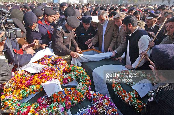 Pakistani Chief Minister of North West Frontier province Akram Khan Durrani takes the last glimpse of a senior police officer before his burial a day...