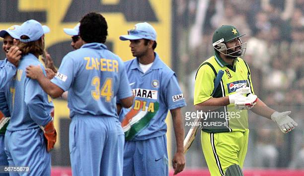 Pakistani cricket team captain InzamamulHaq reacts after his dismissal as Indian cricketers celebrate during the first One Day International match...