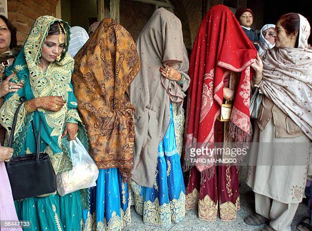 Pakistani earthquake survivor brides in traditional wedding dresses are pictured after a collective wedding ceremony in Peshawar 17 December 2005...