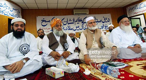 Pakistani hardline opposition leader Maulana Fazlur Rehman and Chief Minister of North West Frontier Province Akram Khan Durrani attend a religious...