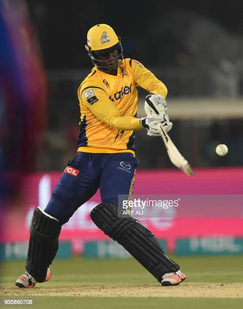Peshawar Zalmi captain Darren Sammy plays a shot during the Twenty20 cricket match of the Pakistan Super League between Peshawar Zalmi and Karachi...