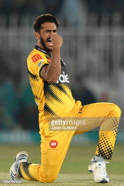 Peshawar Zalmi' Hasan Ali celebrates after taking the wicket of Karachi Kings' SharJeel Khan unseen during the Pakistan Super League T20 cricket...