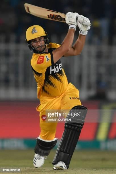 Peshawar Zalmi' Lewis Gregory hits a shot during the Pakistan Super League T20 cricket match between Peshawar Zalmi and Karachi Kings at the...