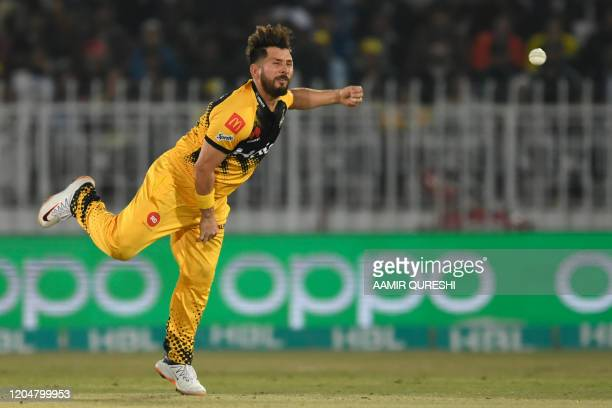 Peshawar Zalmi's Yasir Shah delivers the ball during the Pakistan Super League T20 cricket match between Peshawar Zalmi and Karachi Kings at the...
