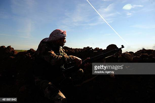 Peshmerga deploys at a emplacement during clashes between Islamic State of Iraq and the Levant militants and Peshmerga in Mawara town of Mosul Iraq...