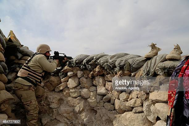 Peshmerga fighter aiming in a tench as he battles Daesh also known as ISIL on a hill overlooking Sinjar town of Mosul on February 27 2015