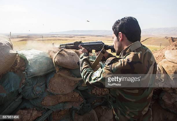 Peshmerga fighters fires of AK47 on the front line close to Bashiqa city 30km from Mosul in Iraq 3 June Bashiqa Kurdish Iraq Autonomy