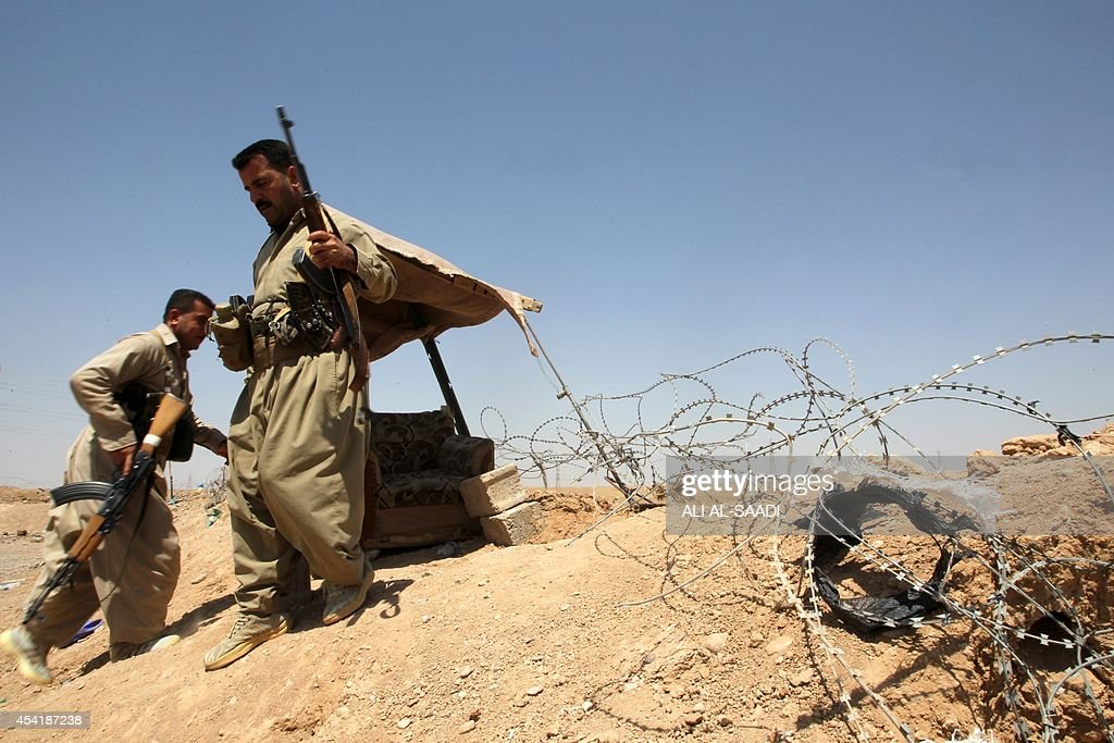 Peshmerga fighters take position at a post in the strategic Jalawla area, in Diyala province, which is a gateway to Baghdad, as battles with Islamic State (IS) jihadists continue on August 25, 2014. Kurdish forces backed by Iraqi air support retook three villages in the Jalawla area, as well as a main road used by jihadists to transport fighters and supplies, peshmerga members said.