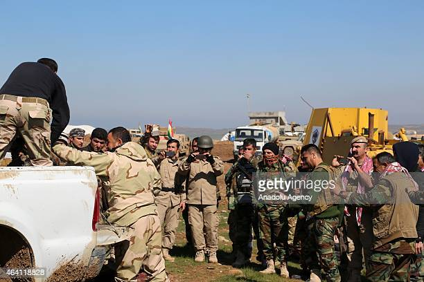 Image contains graphic content Peshmerga forces amass the bodies of Islamic State of Iraq and the Levant at a headquarter in Sultan Abdullah village...