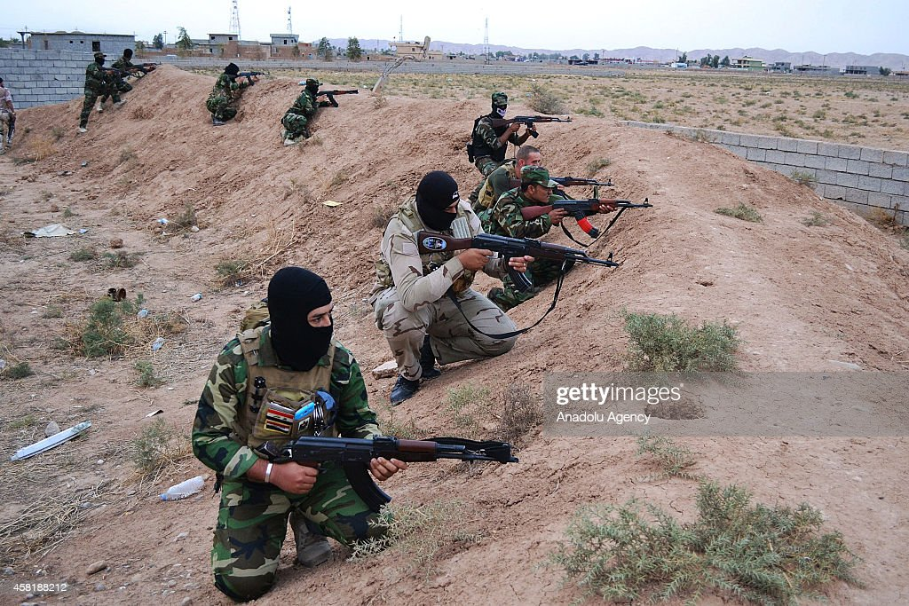Peshmerga forces and Shiite Badr Brigades take positions against Islamic State of Iraq and the Levant (ISIL) in Tuz Khurmatu, Saladin Province, located 55 miles south of Kirkuk, Iraq, on October 30, 2014.