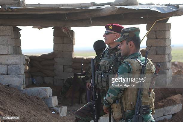 Peshmerga forces belonging to the Kurdish Regional Government are seen as they observe the area at the front of Sinjar town in Mosul Iraq on November...