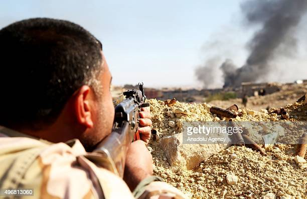 Peshmerga forces belonging to the Kurdish Regional Government are seen at trench while they are attacking to Sinjar town of Mosul Iraq during an...