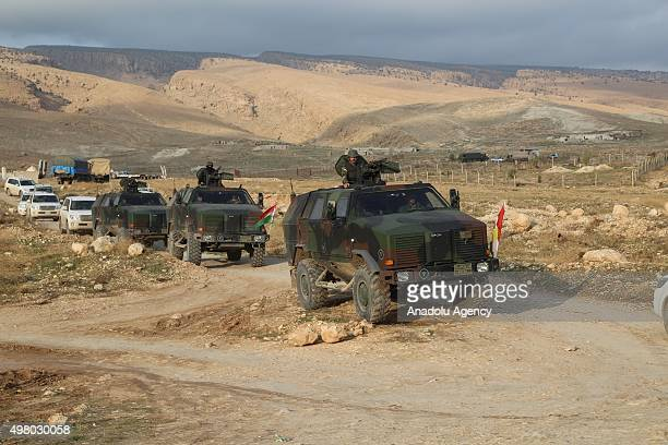 Peshmerga forces belonging to the Kurdish Regional Government in armored vehicles patrol the Sinjar town of Mosul Iraq on November 20 2015 after...