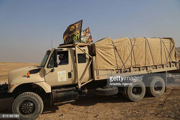 Peshmerga forces halt the armored vehicle convoy of Iraqi Army due to the Shiite flags on the vehicles as the convoy tries to reach Bashiqa town over...