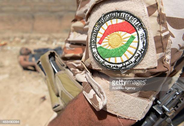 Peshmerga forces inspect the death body of Islamic State militants following Peshmerga forces' seizure of Makhmur by repelling Islamic State formerly...