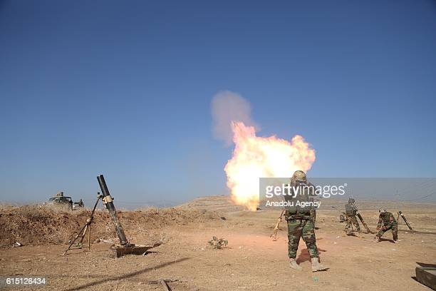 Peshmerga forces located at Mosul's Zardak mountain attack Deash with howitzers during an operation to retake Iraq's Mosul from Deash in Iraq on...