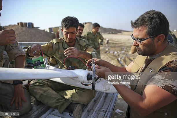 Peshmerga forces located Khazir front at Zardak Mountain assemble an unmanned aerial vehicle with the guidance of US soldiers as they prepare to...