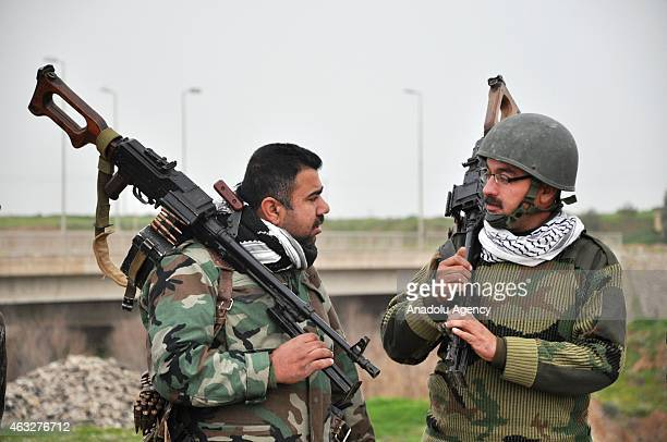 Peshmerga forces mount guard in Hazir front near Erbil Iraq on February 12 2015 against possible ISIL attacks