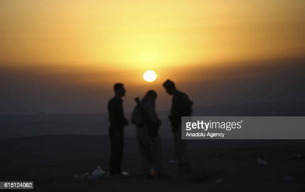 Peshmerga forces stand guard at Hazer region's Wardak village during an operation to retake Iraq's Mosul from Deash in Iraq on October 17 2016 A much...