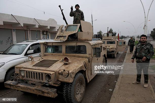 Peshmerga forces stand guard in Kuwair village Erbil city Iraq on January 10 2015 At least 40 Islamic State of Iraq and the Levant militants and 30...