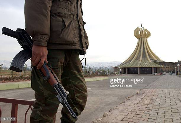 Peshmerga guards the memorial to the victims of the March 16 1988 chemical attacks on Halabja February 24 2004 in Halabja Iraq In Halabja...