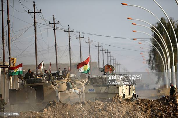 Peshmerga patrol on a road after disposal of the cars with bombs in Bahzan municipality of Bashiqa town in Mosul Iraq on November 7 2016 Iraqi...