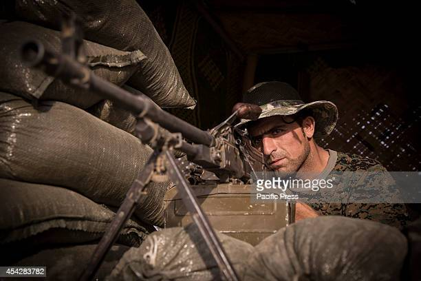 Peshmerga soldier monitors ISIS activity behind his machinegun Khazir refugee camp is located outside Kalak a town halfway on the road between Erbil...