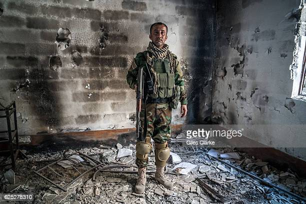 KURDISTAN Peshmerga soldier Muhsin Miro in the ruins of Sinjar The city of Sinjar was overrun by ISIL militants in August 2014 with hundreds killed...