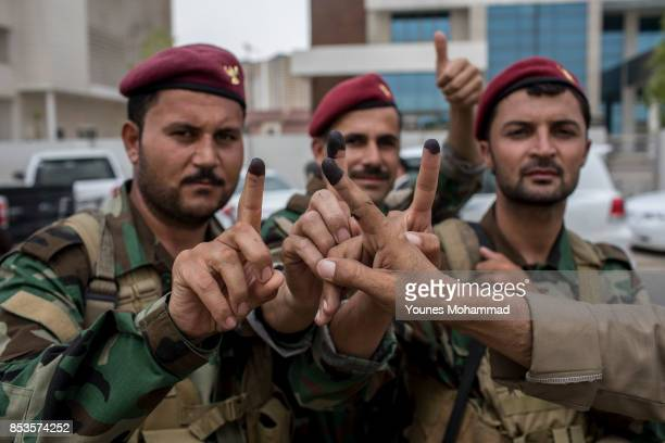 Peshmerga soldiers show their fingers after voting on September 25 2017 in Erbil Iraq Despite strong objection from neighbouring countries and the...